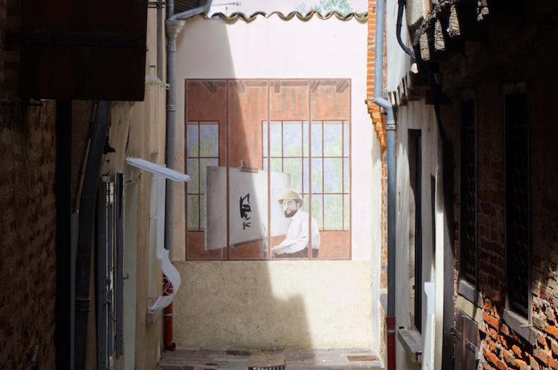 Streetart mit einem Porträt von Toulouse-Lautrec